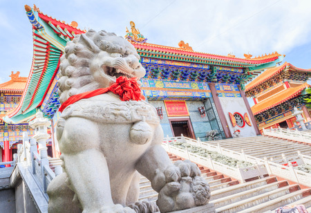 lengnoeiyi: Lion guardian at the entrance to traditional Chinese style temple at Wat Leng-Noei-Yi in Nonthaburi,Thailand