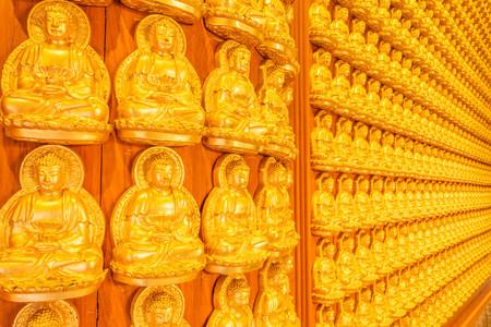 Thousand golden buddha sculpture on a wall at Wat Leng Noei Yi in Nonthaburi,Thailand photo