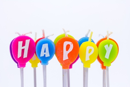 happy colourful candles on white background photo