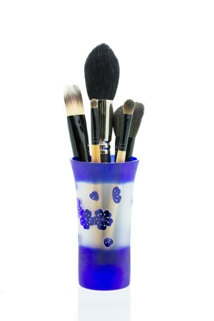 cosmetic brushes in glass  photo