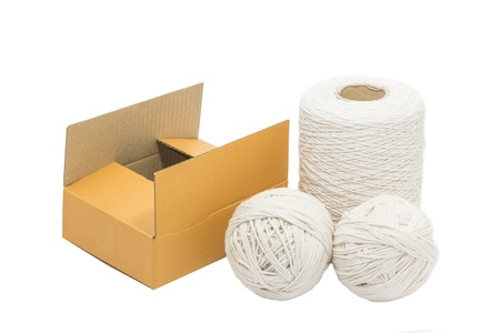 white rope and empty box are equipment for packing the box photo
