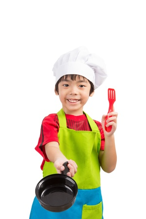 asian young chef boy hold pan and scoop