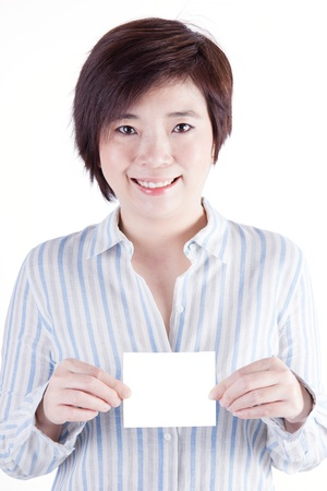 beautiful asian woman smile and show a piece of paper isolated on white background photo