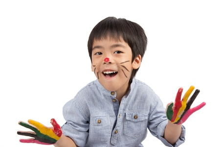 asian boy with colorful painting isolated on white background Stock Photo