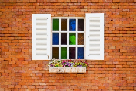 grudge: vintage wooden window on the grudge brick wall  Stock Photo