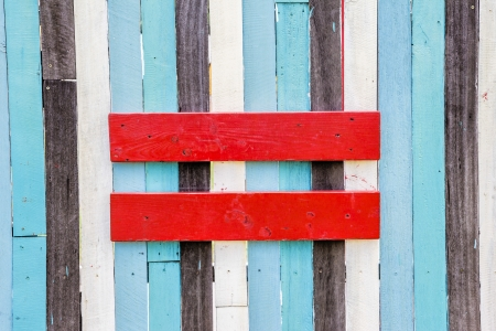 Equal sign symbol on the wooden wall Stock Photo