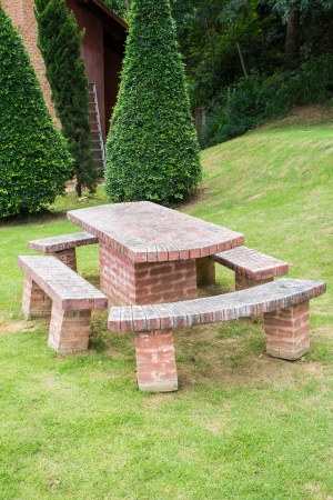 set of brick table and chairs in the garden Stock Photo