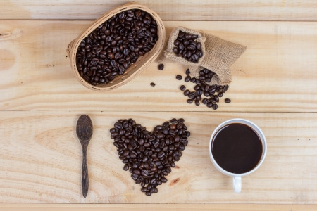 heart shape made from coffee beans spelling i love coffee photo