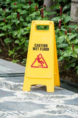 caution wet floor sign in the garden photo