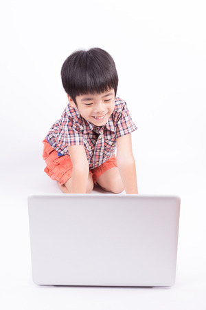 young boy using notebook computer photo