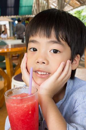 Student outdoors drinking juice photo
