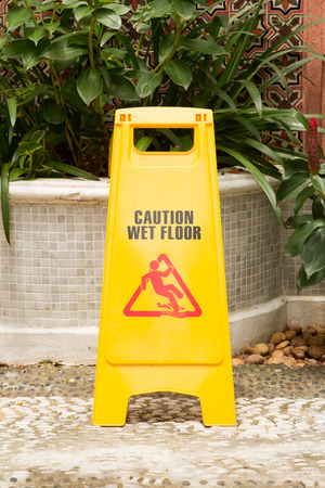 mopped: caution wet floor sign in the garden