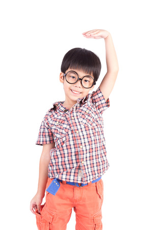 tallness: asian boy growing tall and measuring himself on white background Stock Photo
