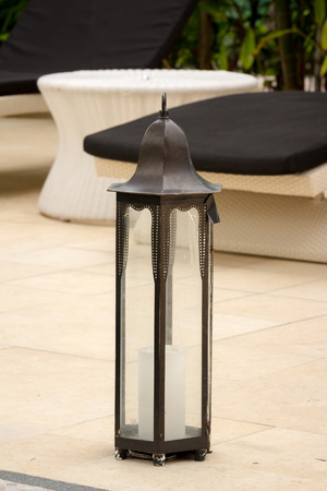 candle lantern on the floor at swimming pool photo