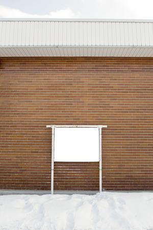 Empty billboard on brick wall photo
