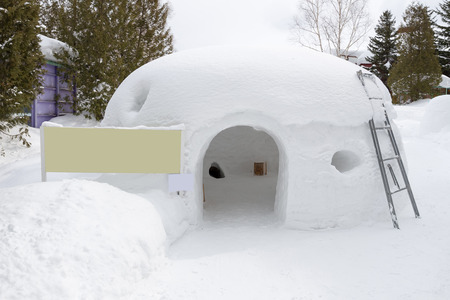 shelter: snow shelter with blank yellow sign Stock Photo