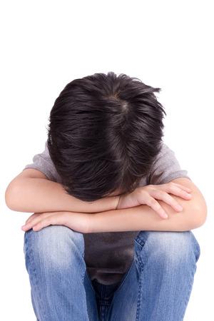 children sad: Sad lonely child isolated on white background Stock Photo