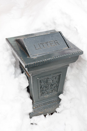 vintage Garbage Can covered by snowy photo