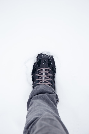 walking boots: Walking boots in the snow Stock Photo