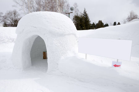 snow shelter with blank sign, for text or picture photo