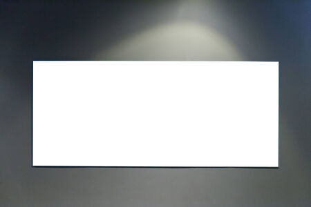 Blank billboard on grey wall with lighting photo