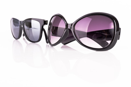 Two sunglasses isolated on white photo