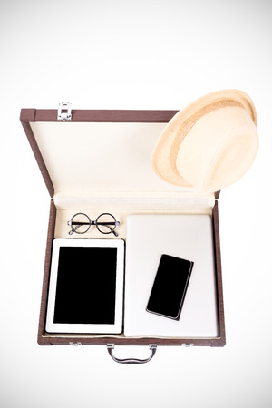 blank tablet, mobile and electronic devices in briefcase (filtered process) photo