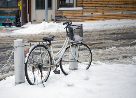 Bicycle in the snow photo