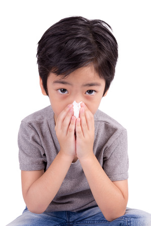 boy wipes a nose a napkin Stock Photo