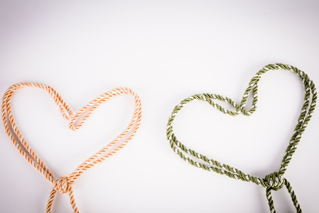 orange and green rope in heart shape with vignette photo