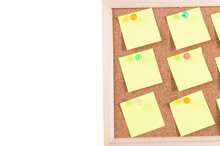 cork board with blank notes isolated on white photo