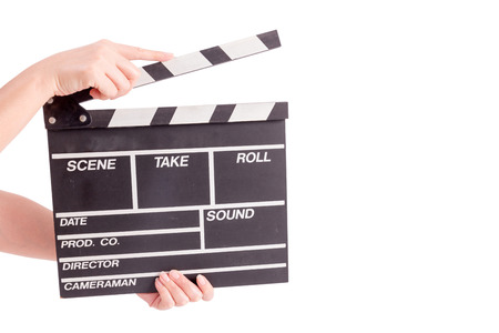 woman holding movie production clapper board isolated on white background photo