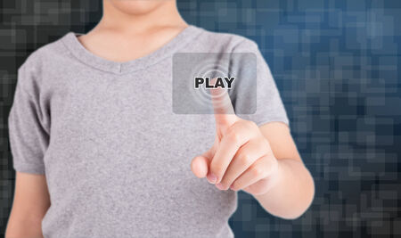 initiate: man pressing play button to start or initiate projects Stock Photo
