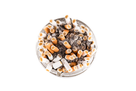 A dirty ashtray with cigarette ash and butts photo