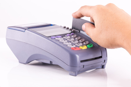 cardreader: Hand Swiping Credit Card On Credit Card Machine Stock Photo