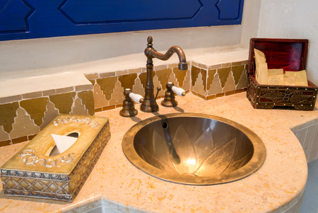 amenities: Moroccan Vintage Style Bathroom with Amenities Stock Photo