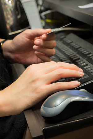 numpad: Woman shopping using computer for credit card payment