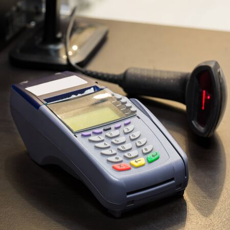 barcode scanner: Credit Card Machine with Barcode Scanner in Background at the store