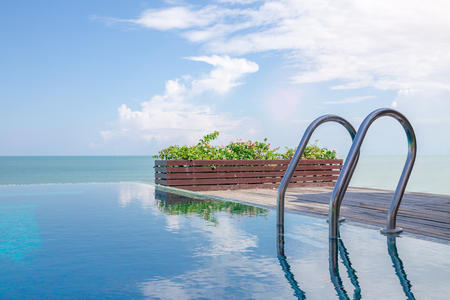 swimming pool home: Beautiful view of Infinity Swimming Pool with sunlight Stock Photo