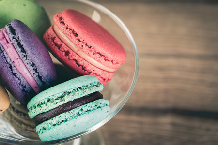 love image: Stack Focus Image Of Colorful French Macarons On Wooden background