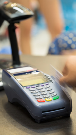 Motion of Hand Swiping Credit Card In Store : Selective Focus Stock Photo