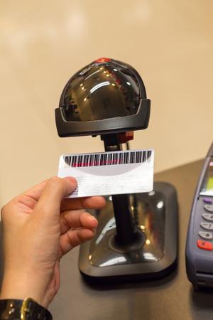 barcode scanning: Black Barcode Scanning Member Card on Human Hand