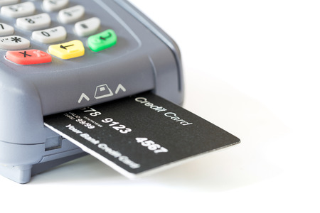 merchant: Credit card and card reader on white background with copyspace Stock Photo