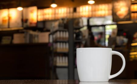 mug of coffee: White Coffee Mug On Wooden Table In Cafe With Copyspace