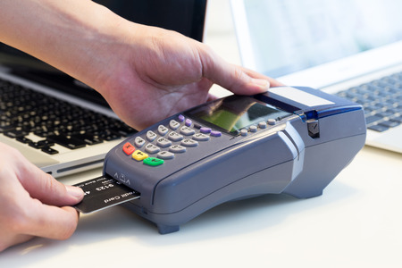 financial cash: Hand Swiping Credit Card In Store