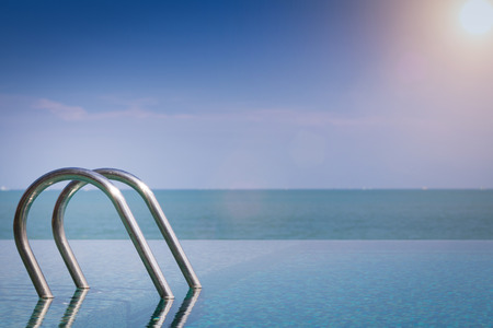 Beautiful view of Infinity Swimming Pool with sunlight Stock Photo