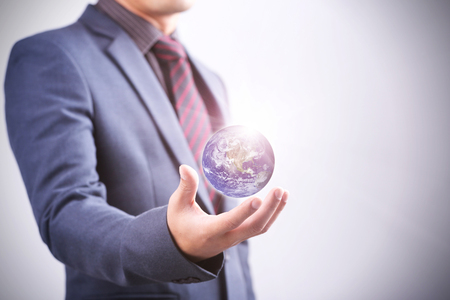 Businessman with the world in his hand.  Stock Photo