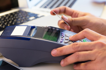cash register: Hand Swiping Credit Card In Store : Selective Focus