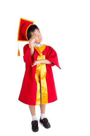 graduacion ni�os: Cute Little Boy Wearing Red Gown Kid Graduation With Mortarboard Isolated On White Background