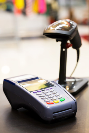 'banking: Credit Card Machine on cashier counter in the store : Selective Focus